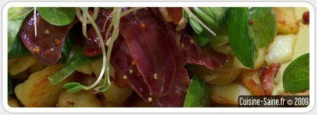 Salade de mâche et magrets de canard sur lit de pommes de terre
